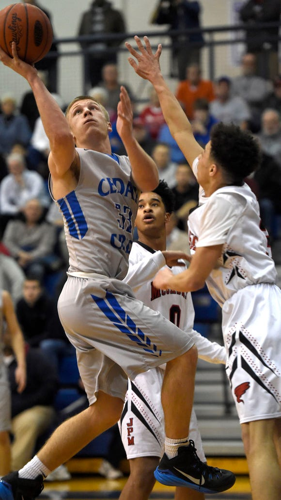 Cedar Crest senior Evan Horn lifts in a layup against McCaskey in the second half of the Lancaster-Lebanon League title game Thursday at Manheim Twp. The Falcons lost, 54-47.
