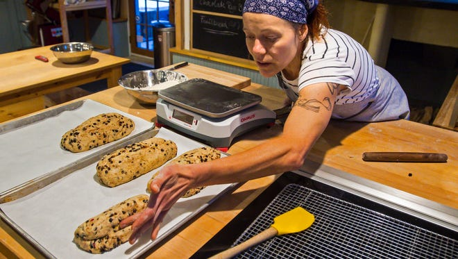 Heike Meyer shapes loaves of stollen, a traditional German Christmas treat, at Brotbakery in Fairfax on Thursday, December 15, 2016.