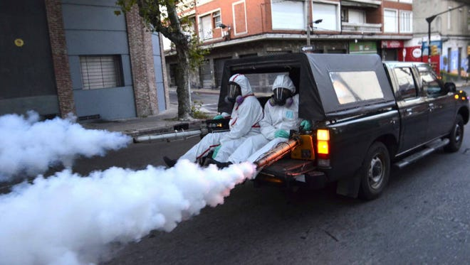 Health workers fumigate for Zika virus-carrying mosquitoes in Montevideo, Uruguay, in February 2016.