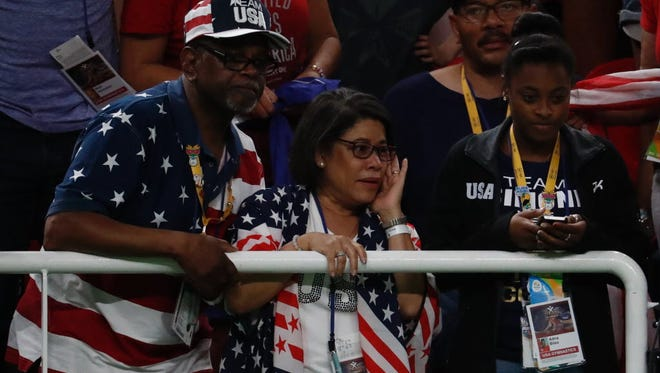 Ron and Nellie celebrate after their daughter Simone and the rest of the U.S. women's  team clinched the gold medal in the Rio Olympic Games on Tuesday.