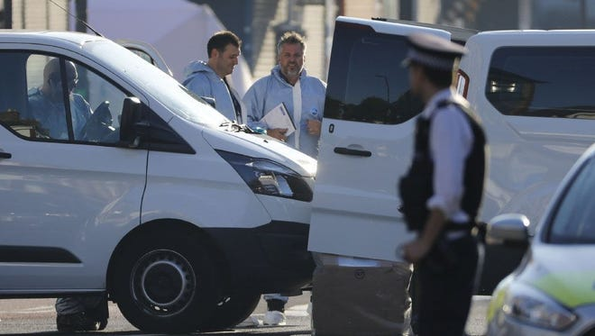 Forensic officers work at the scene in the Finsbury Park area of north London after a van hit pedestrians, on June 19.