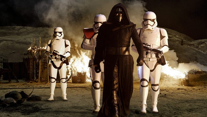 Kylo Ren (played by Adam Driver) with stormtroopers in a scene from 'Star Wars: The Force Awakens.""