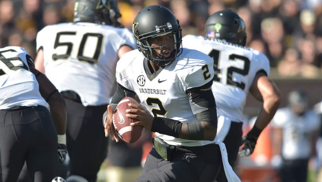 Vanderbilt  quarterback Johnny McCrary (2) drops back to pass during the first half against the Missouri Tigers at Faurot Field on Saturday.
