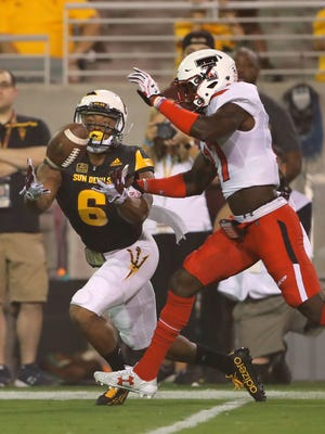 Sep 10, 2016; Tempe, AZ, USA; Texas Tech Red Raiders defensive back Thierry Nguema (17) breaks up a pass intended for Arizona State Sun Devils wide receiver Cameron Smith (6) at Sun Devil Stadium. Mandatory Credit: Mark J. Rebilas-USA TODAY Sports