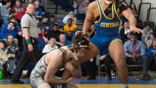 Cape Henlopen's Cory Lawson (left) keeps a tight hold on Sussex Central's Brandon Bautista in his 3-1 victory in the 160-pound final at the Henlopen Conference championships last Saturday at Sussex Central.