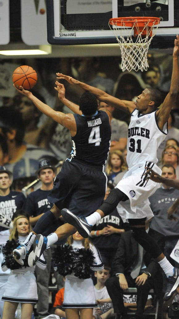 Butler's Kameron Woods tries to block a shot by Villanova's Darrun Hilliard on Dec. 31, 2013 at Hinkle Fieldhouse. Hilliard and Woods are expected to be two key players again when the teams meet this Saturday.