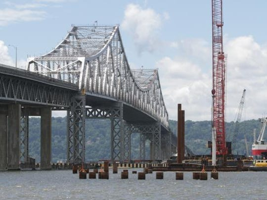Pilings in the foreground have been driven to their full depth and are at their completed height, as viewed from a boat near the construction site of the Tappan Zee Bridge project, photographed June 5, 2014. The new span will be directly supported from these pilings.