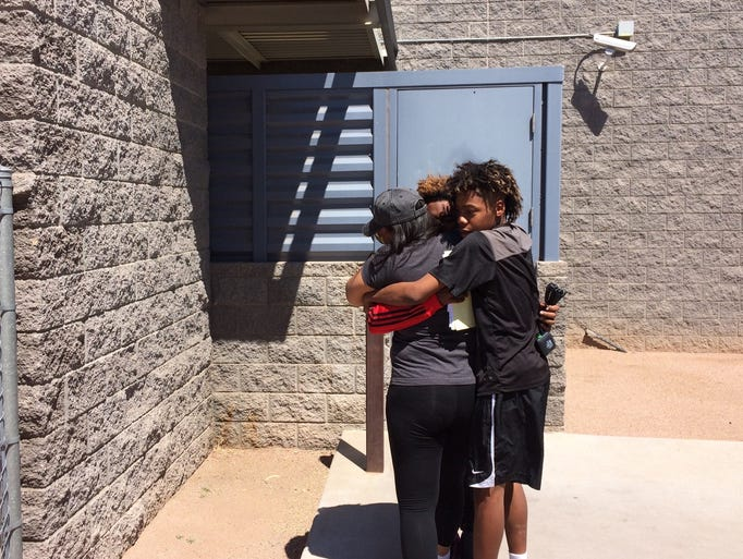Nathaniel Thomas gets a hug on his release from custody