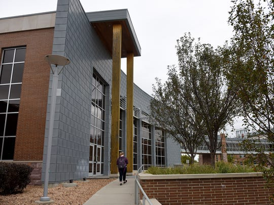 A student walks to class at the University Center on