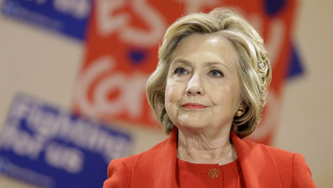 Democratic presidential candidate Hillary Clinton talks with local politicians and immigrant activists in New York, Wednesday, April 13, 2016. The meeting of immigrants and advocates was held, in part, to announce the New York Immigrant Action Fund's endorsement of Clinton. (AP Photo/Seth Wenig)