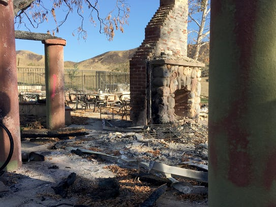 A fireplace stands in the ashes of the home in Wheeler