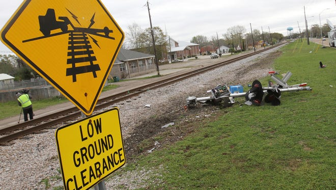 Debris from the railroad crossing signal litters the north side of the railroad tracks on Wednesday, March 8, 2017,  in Biloxi, Miss., where a CSX train hit a casino tour bus the day before.  (John Fitzhugh/The Sun Herald via AP)