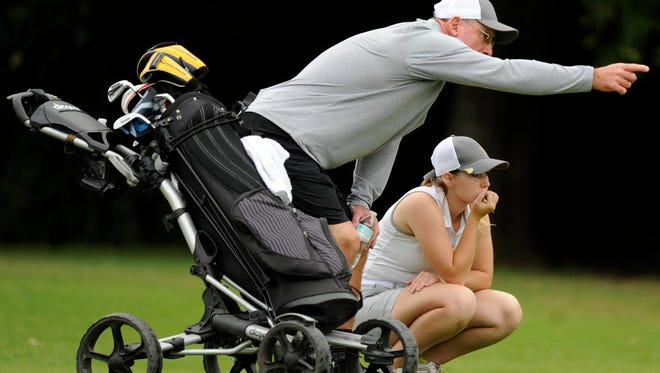 Blanket coach Monty Jones talks with golfer Marki Kinkade on the eighth hole during the final round of the Class 1A UIL state golf tournament in 2017 at Lions Municipal Golf Course in Austin. Kinkade shot a 79 on the round to win the state title and lead Blanket to the team title .