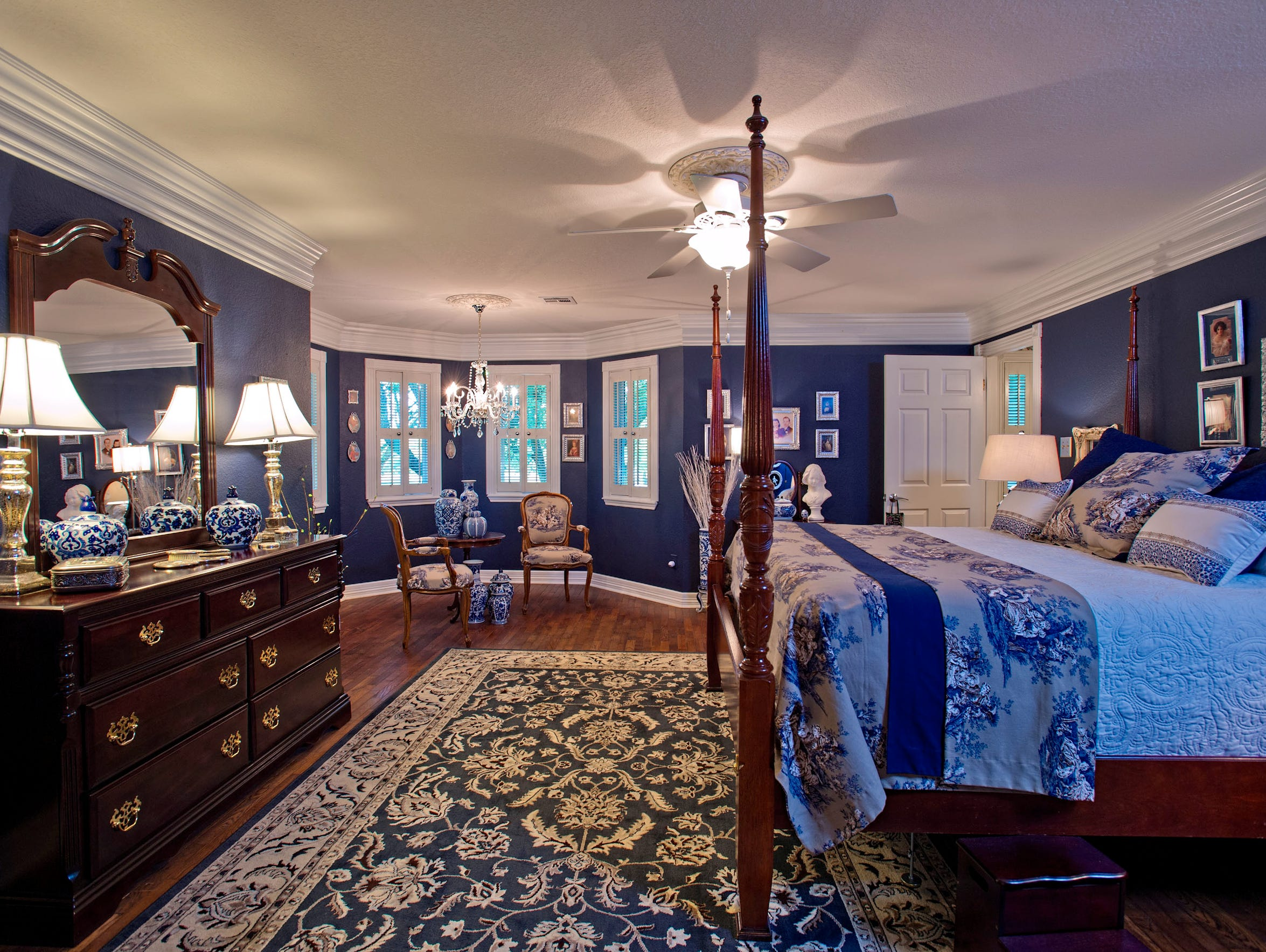 The master bedroom includes a cozy bay window sitting