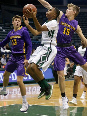 West Allis Hale's Emerald Martin (4) makes a shot while being defended by New Berlin Eisenhower's Nick DeFrance (15) during their game Wednesday, January 3, 2018 at the BMO Harris Bradley Center in Milwaukee, Wis. New Berlin Eisenhower beat West Allis Hale 69-52.  MARK HOFFMAN/MILWAUKEE JOURNAL SENTINEL  wcn_swn_boyshoops_0103