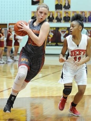 """McCutcheon's Colleen Leonard is pursued down court by Jeff""""s Brandi Norton during the first game of Friday's girls sectional at McCutcheon."""
