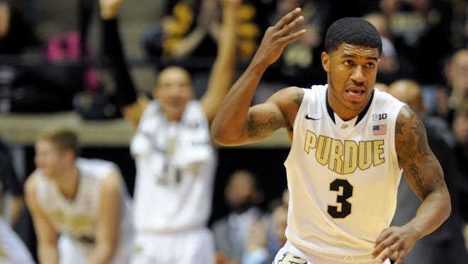 Purdue guard Ronnie Johnson celebrates a three-point basket against Indiana inside Mackey Arena, Saturday, February 15, 2014, in West Lafayette.