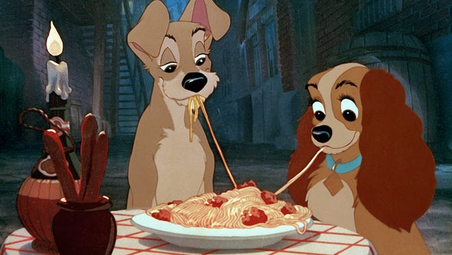 """Tramp and Lady enjoy a meal at Tony's Restaurant in the 1955 Disney classic """"Lady and the Tramp."""""""