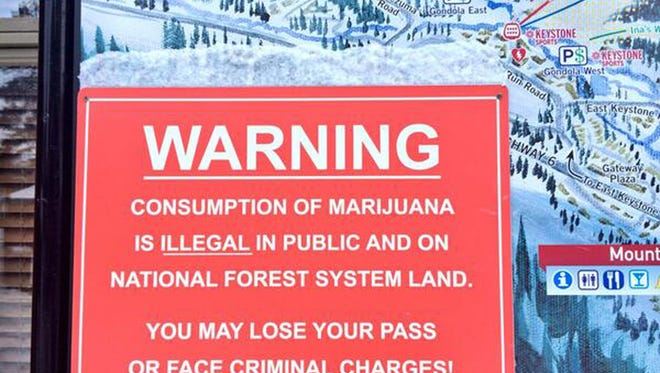 This sign at Keystone Resort in Colorado was one of many erected at the state's ski areas this past winter to remind locals and tourists that public marijuana consumption is illegal, as is marijuana use on federal lands that host most ski areas. A new Colorado report says up to 90% of recreational marijuana sales in ski towns are being made by tourists.