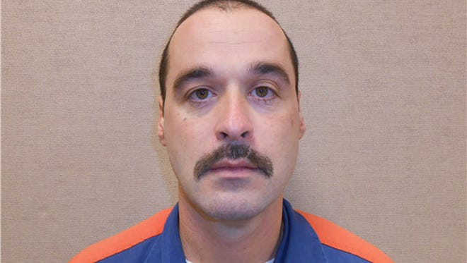 Michael David Elliot was serving life in prison for four murders in 1993.