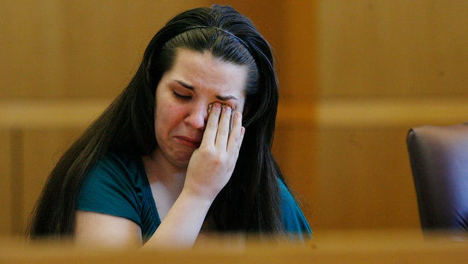 Jennifer Mee reacts as the jury selection begins her murder trial Sept. 17, 2013, at the Pinellas County Justice Center in Clearwater, Fla.