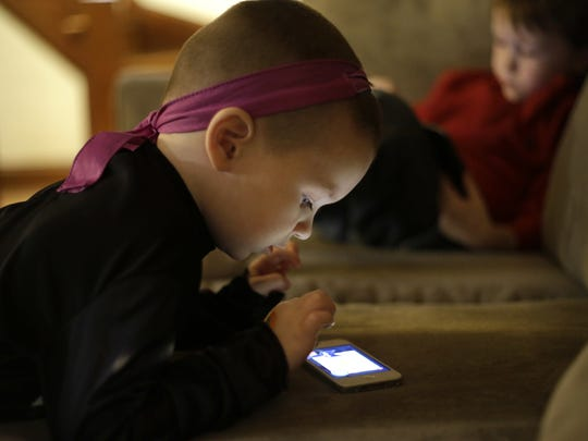 While some research suggests screen time can have educational value for children, other research points to screen addiction and developmental hindrances when screens are used in large doses.