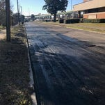 PHOTOS: Old East Hill residents upset over brick repaving