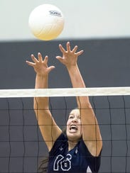 Shalom's Haley Bricker (16) pushes the ball over the