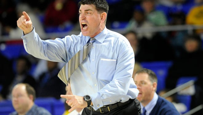 Grace Christian's boys coach Mike Doig yells to his team during a state Class A semifinal game against Memphis Mitchell on March 13 in Murfreesboro.