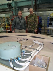 Directorate of Industrial Operations Division Chief Jim Woolf shows Netherlands Liaison Officer First Lt. Johan Thomissen a recently recapitalized Patriot radar pedestal.