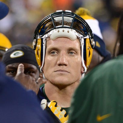Green Bay Packers linebacker A. J. Hawk on the sidelines