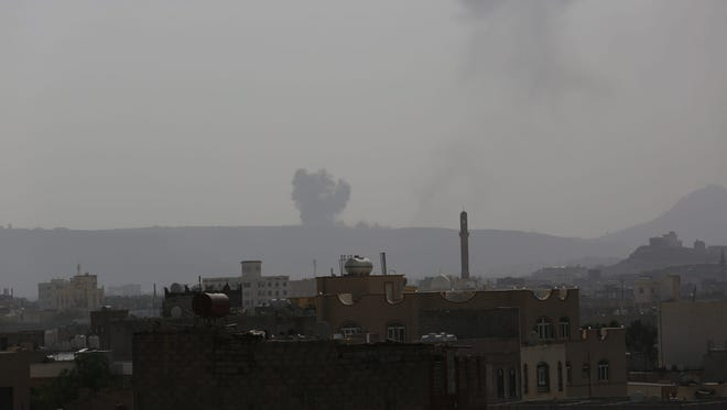 Smoke billows rise from a Houthi-controlled military post following airstrikes carried by the Saudi-led coalition, in Sanaa, Yemen, June 7, 2015.