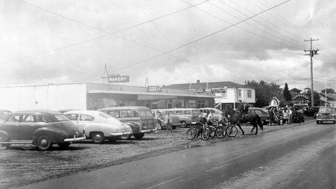 An early photograph of River Road N in Keizer when it had just two lanes and gravel on each side.