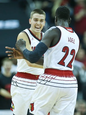 Louisville's Ryan McMahon celebrates with teammate Deng Adel during the Cards' 71-62 win over the Hoosiers Saturday, Dec. 9, at the KFC Yum! Center in downtown Louisville.