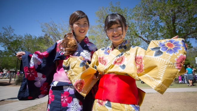 Manami Ishikawa and Sakina Shirai from Japan pose for the camera during the Las Cruces International Festival at Pioneer Women's Park on April 2, 2016.