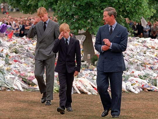Prince Charles, Prince William and Prince Harry inspect