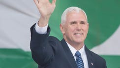 Vice President Mike Pence waves before delivering remarks