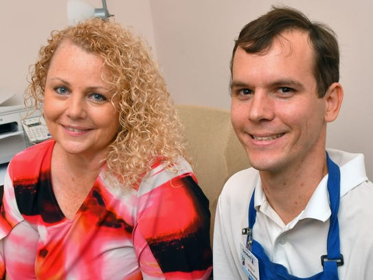 Samantha Finlayson, job placement specialist, is pictured with Andrew Howes, 26, who is deaf and is part of the the workforce through the Goodwill job placement program. Howes works as a floor clerk at Goodwill's West Melbourne store location.