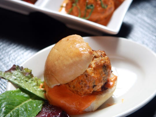 Chicken meatball with buffalo gravy slider and other