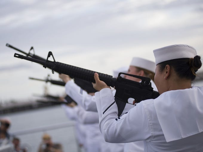 Sailors perform a rifle salute during the dual interment
