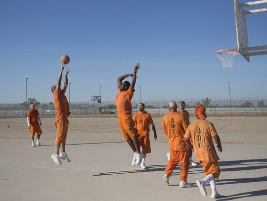 Death-row inmates play a game of basketball at the