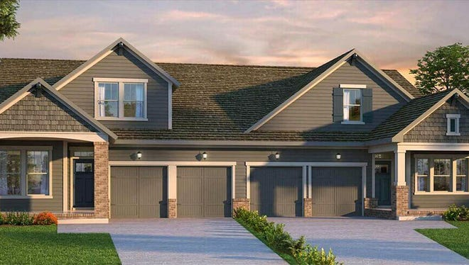 An artist's rendering of David Weekley Homes' villas in Durham Farms. They are built in pairs with attached garages between them.