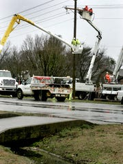 This file photo shows a crew of Murfreesboro Electric Department employees work to repair a utility pole along Warrior Drive.