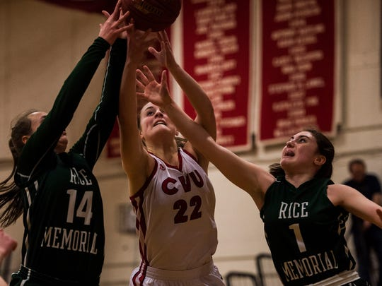 CVU #22 Lindsey Albertelli fights for the rebound against Rice #14 Lisa Sulejmani and #1 Kristen Varin during their game Monday night, Feb. 5, 2018, in Hinesburg.