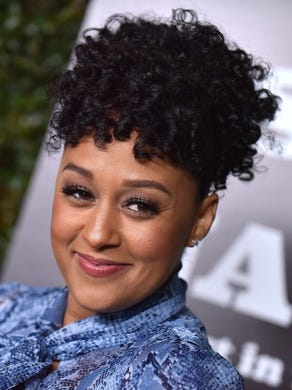 """In an Instagram post in June 2020, Tia Mowry shared her experience of watching <a href=""""https://www.usatoday.com/story/entertainment/celebrities/2020/06/05/tia-mowry-recounts-growing-up-biracial-racism/3153174001/"""">her&nbsp;mother, who is Black, get racially profiled.</a> &quot;During our #sistersister days when traveling for work we would often fly first class. There were several times my mother was asked if she was in the right seat,&quot; she wrote. &quot;Another incident that stood out for me was when we were buying our first home as a family. My mother walked in the house model with us asking for a brochure. A person had said the houses were sold out. My (white) dad walked in and it was a different story.&quot;"""