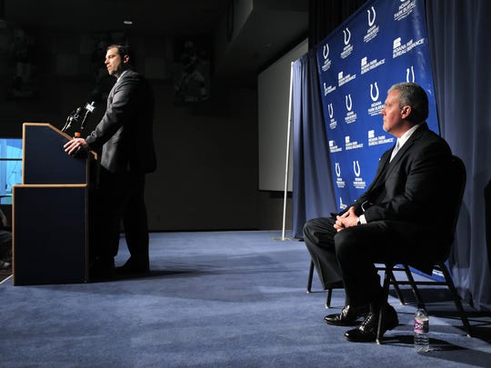 FILE - Colts owner Jim Irsay listens as Ryan Grigson talks with the media Jan. 11, 2012.