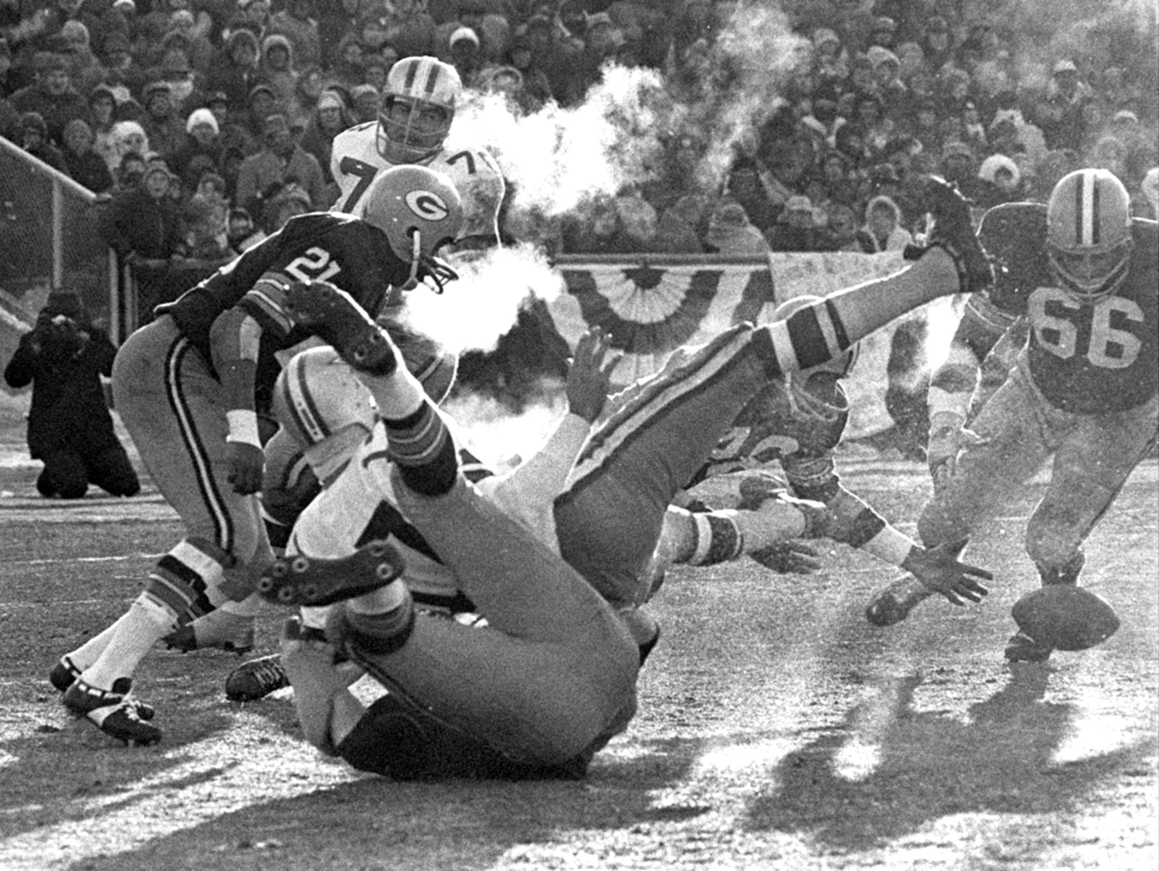 Players spill in all directions after Packers linebacker Lee Roy Caffey forces a fumble by Cowboys quarterback Don Meredith in the third quarter of the 1967 NFL Championship Game on Dec. 31, 1967 at Lambeau Field. Packers defensive back Herb Adderley recovered the ball but Green Bay failed to score off the turnover.