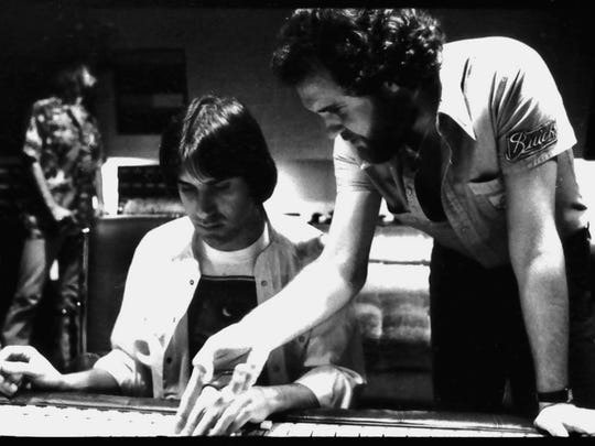 Dan Fogelberg, left, and producer Norbert Putnam working
