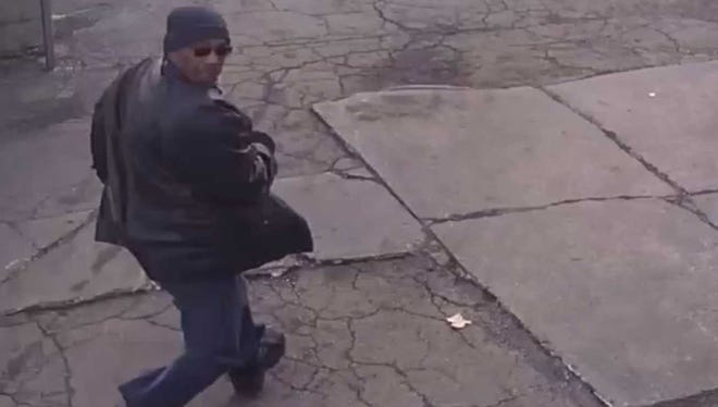 Milwaukee police are looking for this man in the robbery of a dry-cleaning business
