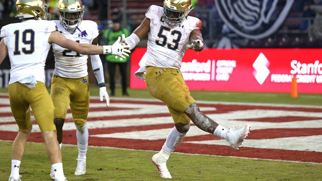 Notre Dame defensive lineman Khalid Kareem (53) celebrates after recovering a fumble in the end zone against Stanford.